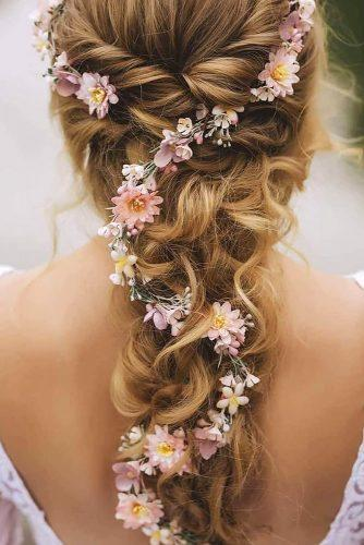 wedding hairstyles with flowers pink on messy cascading hair lioneerphoto via instagram