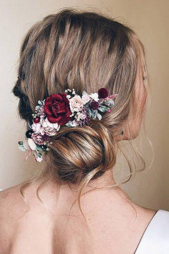 wedding hairstyles with flowers side bun with pink red white roses serenitywedding