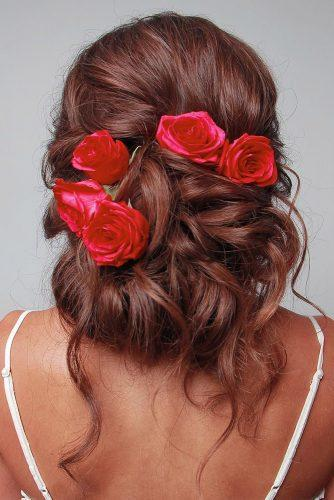 wedding hairstyles with flowers volume messy updo with red roses blushandmane
