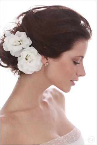wedding hairstyles with flowers white on elegant swept back brown hair low bun felipe lessa