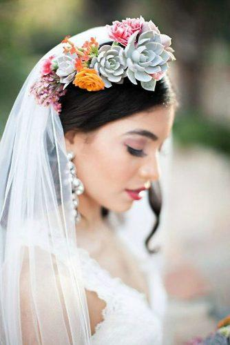 wedding hairstyles with veil and flower halo with succulents katie beverley