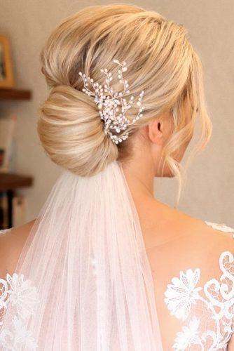 wedding hairstyles with veil chignon with accessory sweethearts_hair
