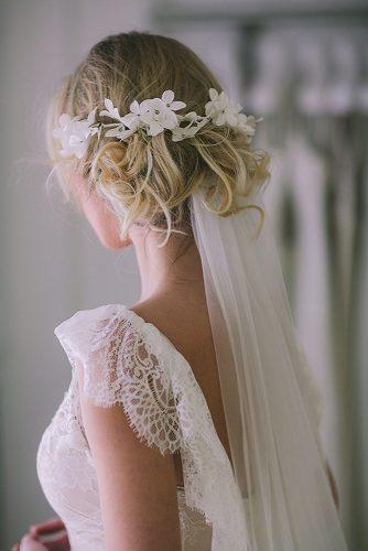 wedding hairstyles with veil curly messy blonde updo with white flower accessorie pahountis photography