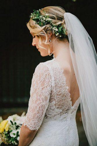 wedding hairstyles with veil for blonde hair with greenery and curls lev kuperman