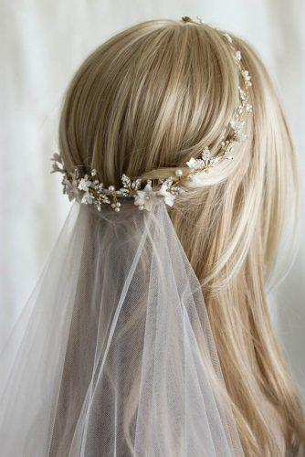 wedding hairstyles with veil gentle half up half down with gold halo taniamarasbridal