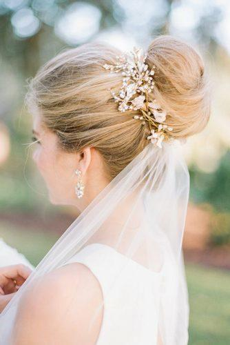wedding hairstyles with veil high bun with veil white gold flower accessorie and richard photo lab