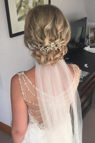 wedding hairstyles with veil on blonde bridal hair with low curly updo jojo_hicks_mua via instagram