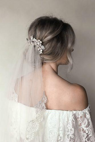 wedding hairstyles with veil simple low updo with veil and silver flower hairpin untamedpetals