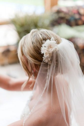 wedding hairstyles with veil updo on blond hair with rose flowers tara draper photography