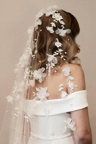 wedding hairstyles with veil with white flowers taniamarasbridal