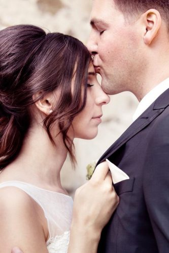wedding photo book bride and groom kiss forehead c bay photo design