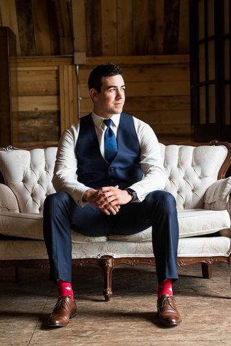 wedding photo book groom photo shoot on a sofa paisley photography