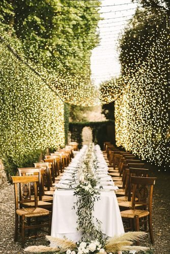 wedding table decorations outdoor long table decorated with greenery tablerunner gabrielefaniphotographer