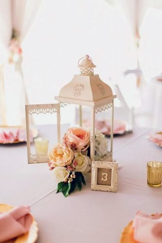 wedding table decorations roses in white vintage lantern and tablenumber in frame stacypaulphotography