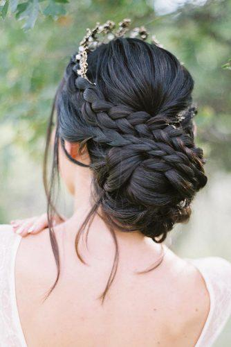 wedding updos with braids chignon on dark hair with loose curls hairandmakeupbysteph