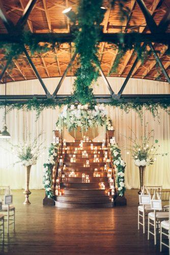 winter wedding decorations arch with flower and candles kendra elise
