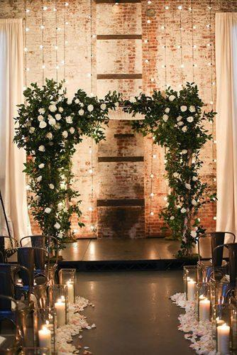 winter wedding decorations arch with white rose and lamp alisonconklin