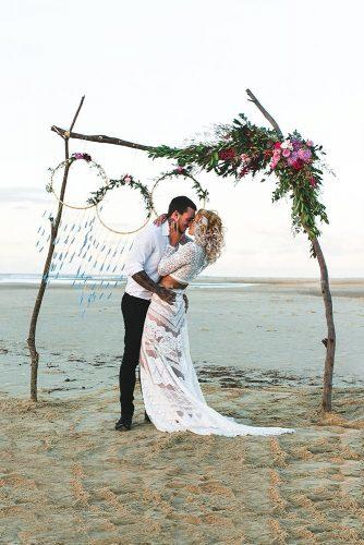 beach wedding decoration ideas boho wooden arch decorated with flowers greenery and dreamcatchers adriana watson photography