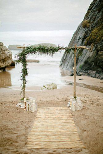 beach wedding decoration ideas boho wooden arch decorated with greenery grace photography