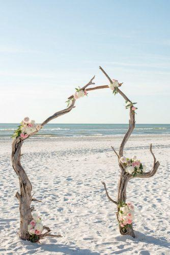 beach wedding decoration ideas dry woodland altar decorated with flowers caroline & evan photography via instagram