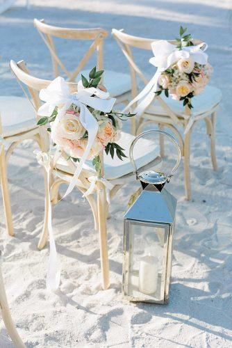 beach wedding decoration ideas flowers and ribbons decorate chair on ceremony natalie watson photography