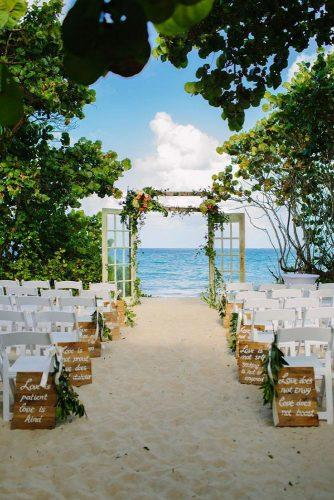 beach wedding decoration ideas old door altar with signs on wood aisle floridian social