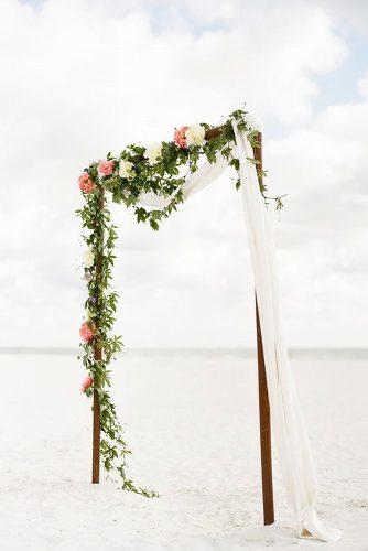 beach wedding decoration ideas wooden arch with flowers and white cloth aaron snow