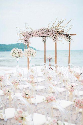 beach wedding decoration wooden arch with rose roses transparent chairs with flowers phan vu tien