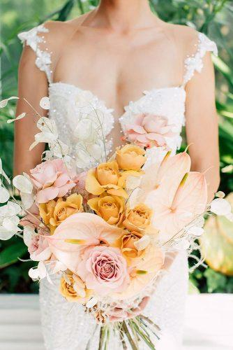 beautiful wedding bouquets bohehian mustard roses light pink flowers purpletreephotography