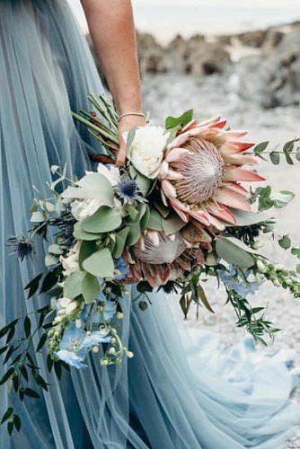 beautiful wedding bouquets cascading protea with grey leaves clarekinchinphotography