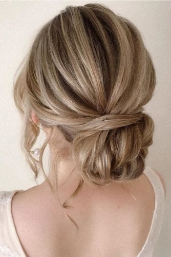 bridesmaid updos elegant simple low textured bun pearly.hairstylist