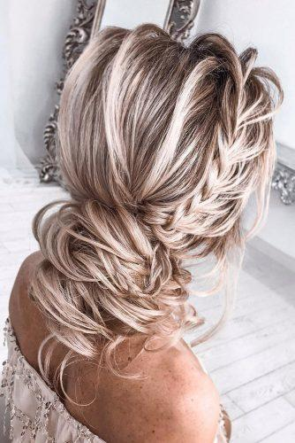 bridesmaid updos low slightly messy bun with side braids tatistylespb