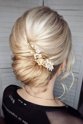 bridesmaid updos on medium blonde hair bup with pin bridal_hairstylist