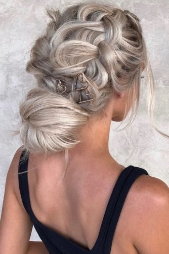 bridesmaid updos simple braided low bun on blonde hair with heart shaped pins hairby_chrissy