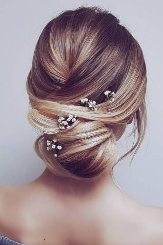 bridesmaid updos simple low bun with baby breath hairbyhannahtaylor