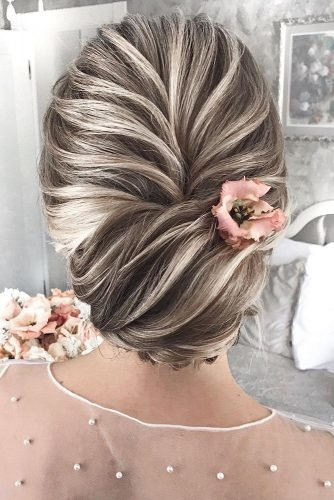bridesmaid updos textured elegant updo on blonde hair with pink flower mpobedinskaya