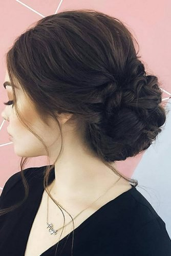 bridesmaid updos volume low bun with loosecurls on dark hair kenraprofessional