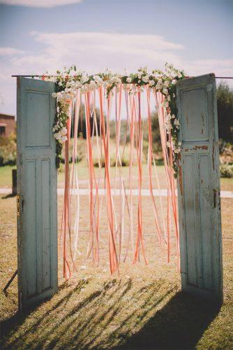 cheap wedding decorations arch with ribbons and blue wooden doors soul pics