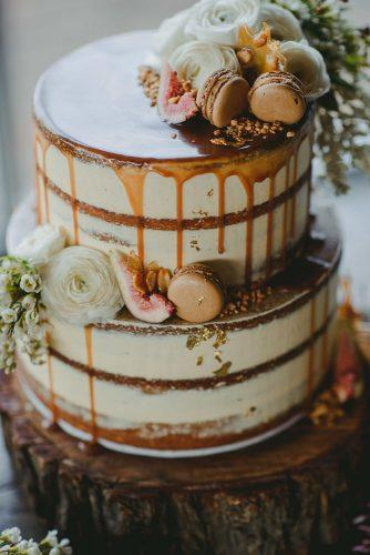 drip wedding cakes small naked with caramel drip flowers and macaroons cakedbycarissa