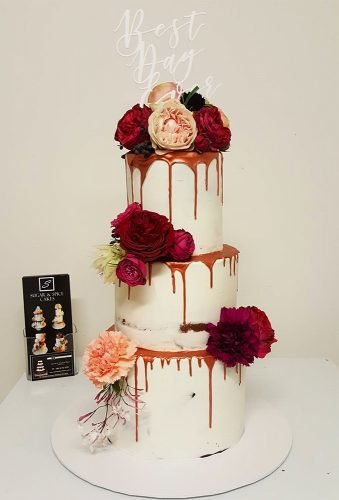 drip wedding cakes wedding cake with flowers sugarandspicecakes