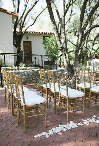 gold wedding decorations gold chair in wedding alise Adrienne Gunde Photography