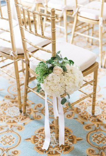 gold wedding decorations gold chair white flower Shea Christine Photography