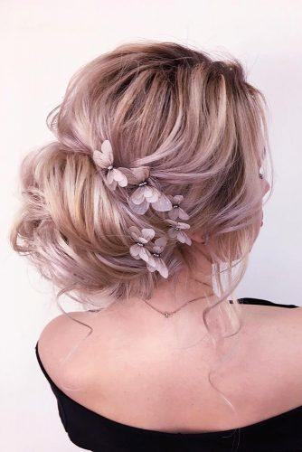 hair accessories inspiration volume bun decorated with gentle flowers xenia_stylist via Instagram