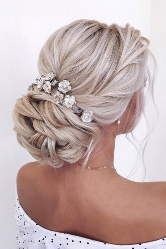 hair accessories inspiration wedding hairstyle volume low bun with silver flowers on blonde hair xenia_stylist