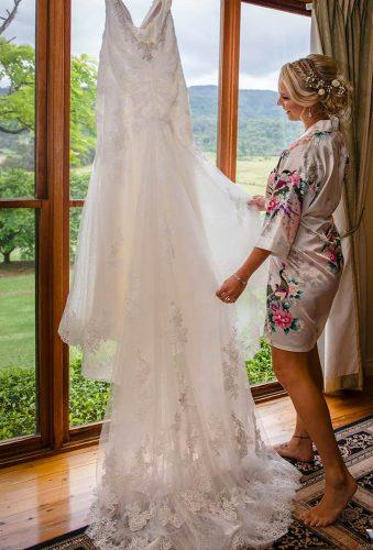 hanging wedding dress bride and wedding dress victorpereraphotography