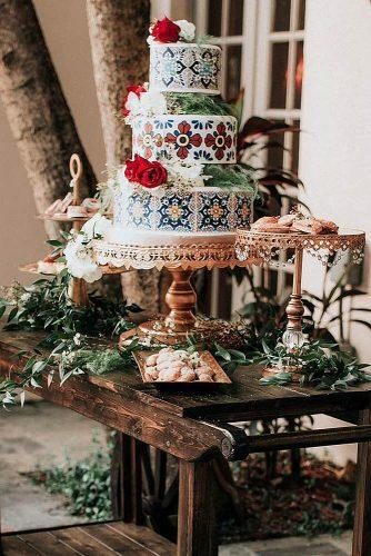 mexican wedding cake ideas cake with mexican patterns on a wooden table honeys cakes via instagram