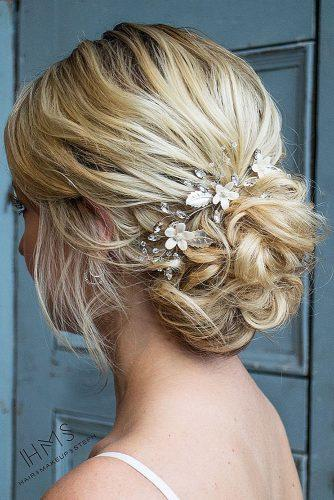 mother of the bride hairstyles curly low bun on blonde hair hairandmakeupbysteph
