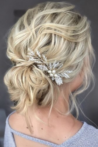 mother of the bride hairstyles curly messy low bun on blonde hair with silver and pearls pin martinajagr