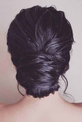 mother of the bride hairstyles elegant chignon on dark hair bridal_hairstylist