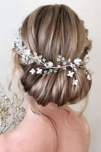 mother of the bride hairstyles elegant low updo with flower halo pearly.hairstylist